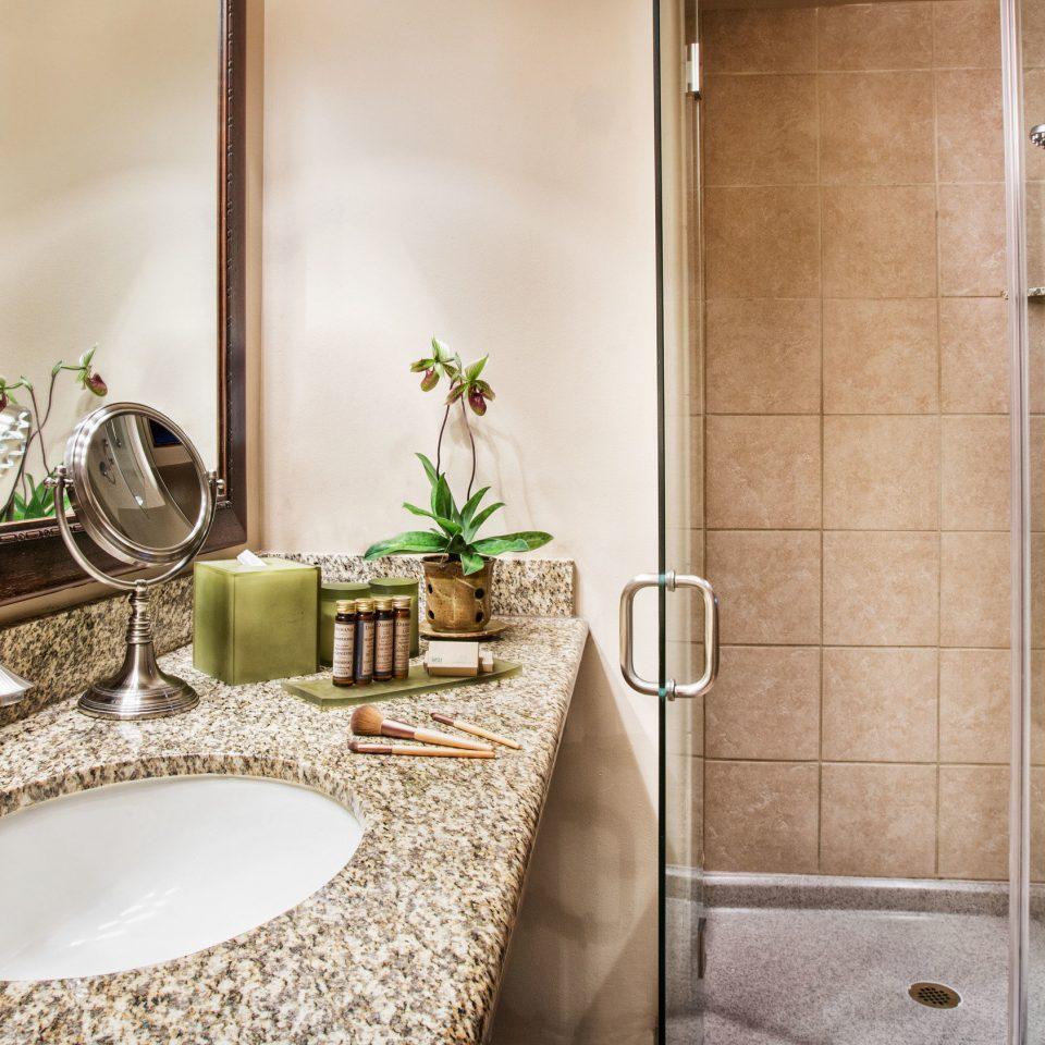 bathroom toilet mirror sink plumbing fixture home Suite flooring Bath
