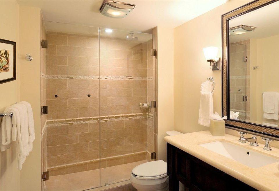 Bath bathroom mirror property sink toilet home Suite tile tan tiled