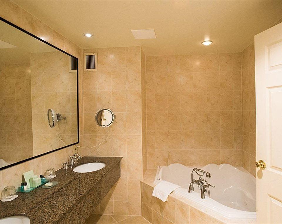 bathroom sink property mirror Suite plumbing fixture toilet tan Bath