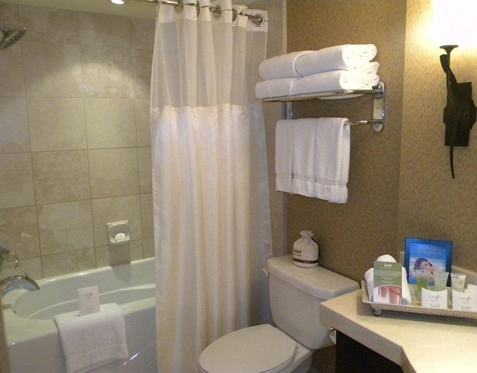 bathroom property sink toilet plumbing fixture towel Suite rack tub Bath