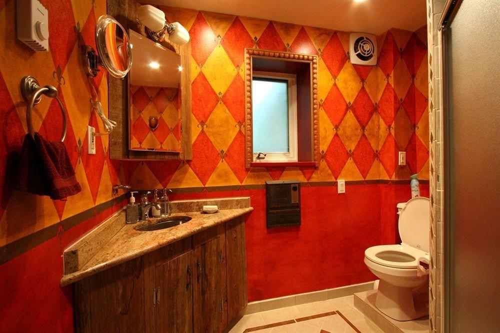 bathroom red toilet sink Suite Bath