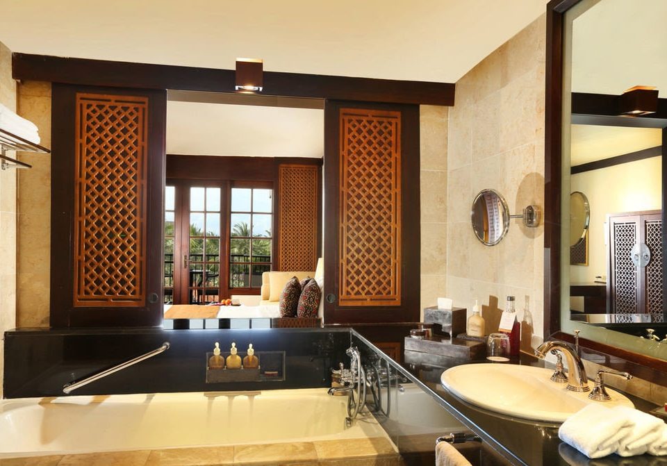 bathroom property sink living room home Suite condominium cabinetry counter Villa tub bathtub Bath