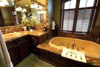bathroom tub property sink bathtub swimming pool Suite home mansion cottage Bath Villa tile tiled