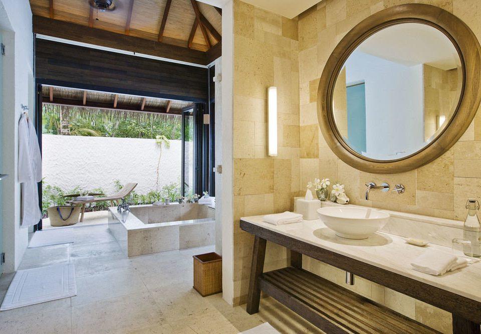 bathroom sink mirror property home cottage Suite Villa farmhouse mansion tub tile Bath bathtub tiled