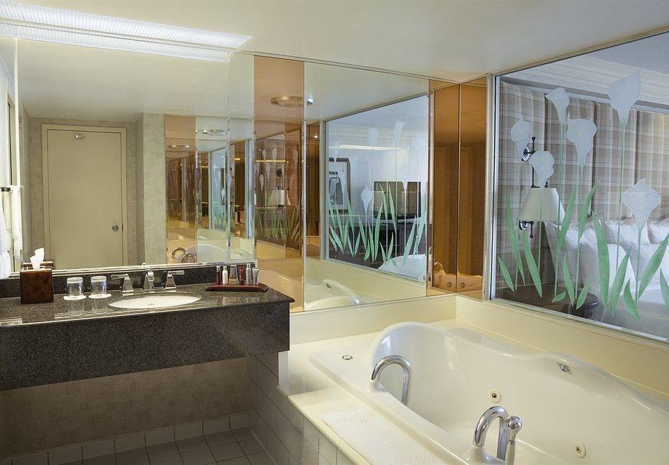 bathroom sink property mirror house bathtub home Suite swimming pool tub condominium mansion Villa vessel Bath toilet tile