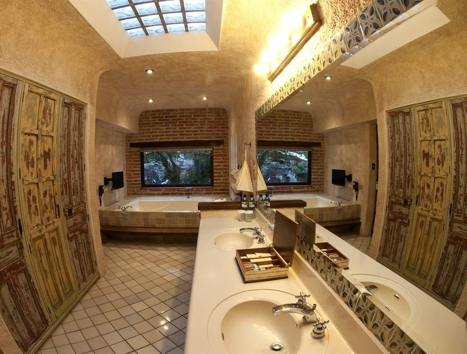 bathroom property sink toilet swimming pool home mansion cottage Suite counter Villa Bath tile tiled