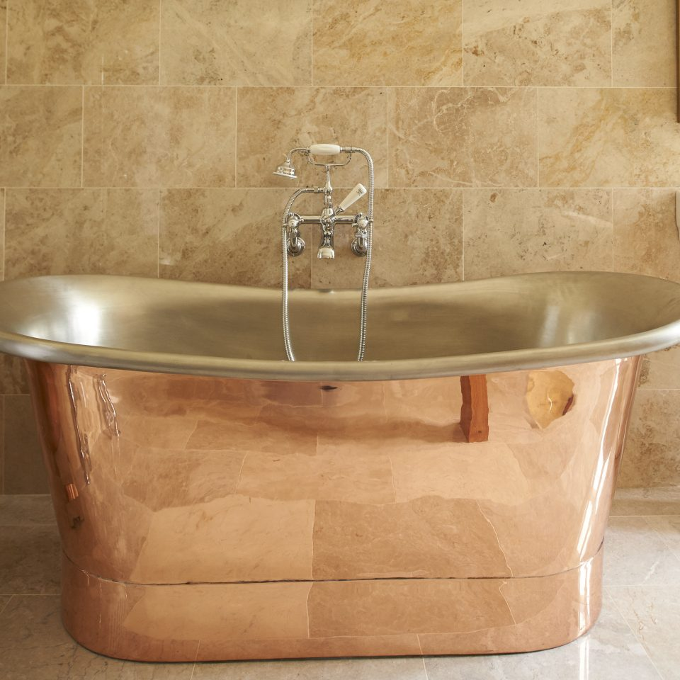 Trip Ideas man made object bathtub bathroom sink plumbing fixture bidet stone tub Bath water basin tan