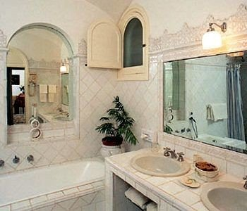 bathroom property sink mansion cottage Villa toilet Bath tub tiled stone