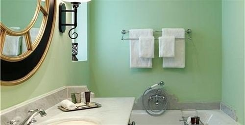 bathroom sink green mirror property toilet plumbing fixture bidet bathtub painted bathroom cabinet