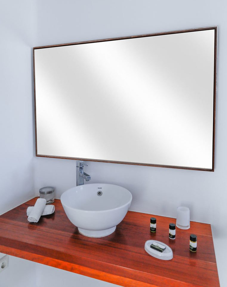 bathroom mirror sink plumbing fixture lighting bidet bathtub bathroom cabinet ceramic rectangle