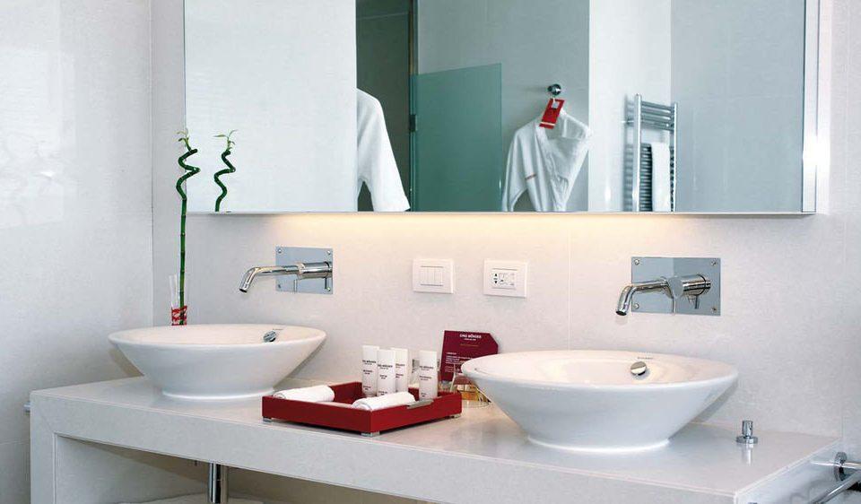 bathroom sink mirror bidet plumbing fixture vessel bathtub ceramic toilet bathroom cabinet flooring water basin