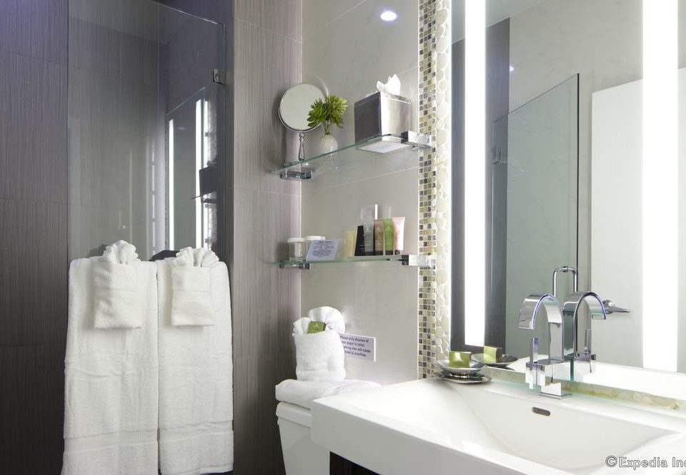 bathroom mirror sink toilet towel property bathtub white plumbing fixture bidet bathroom cabinet flooring rack
