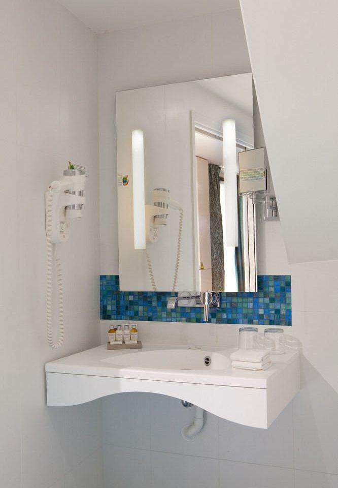 bathroom sink toilet white plumbing fixture bidet bathtub bathroom cabinet tile tiled