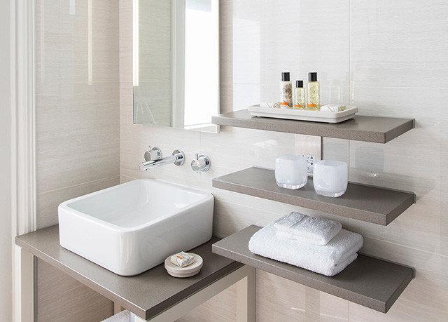 bathroom sink mirror plumbing fixture bidet bathtub ceramic bathroom cabinet flooring shelf counter