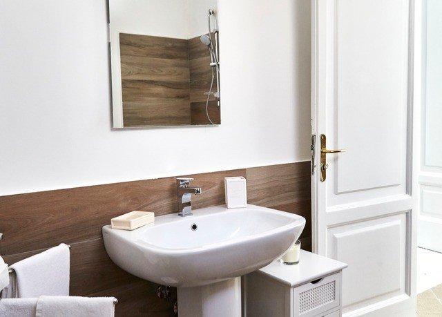 bathroom sink mirror bidet plumbing fixture bathtub bathroom cabinet flooring toilet