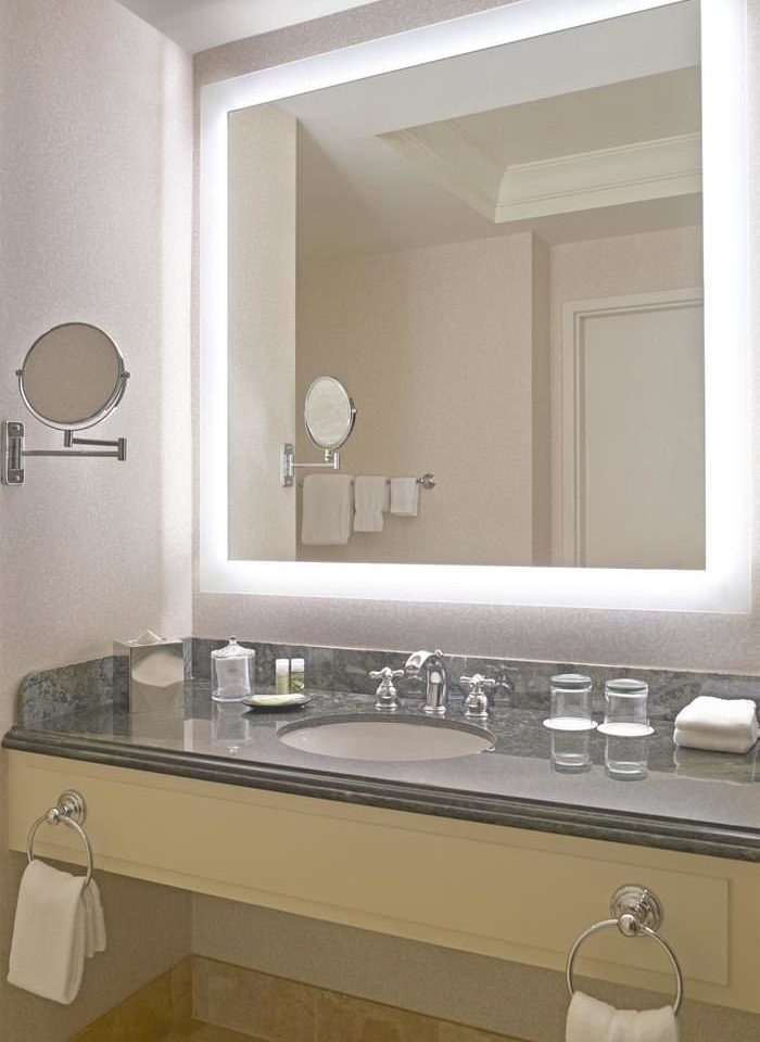bathroom mirror sink property plumbing fixture home countertop bathtub bathroom cabinet cabinetry towel flooring bidet