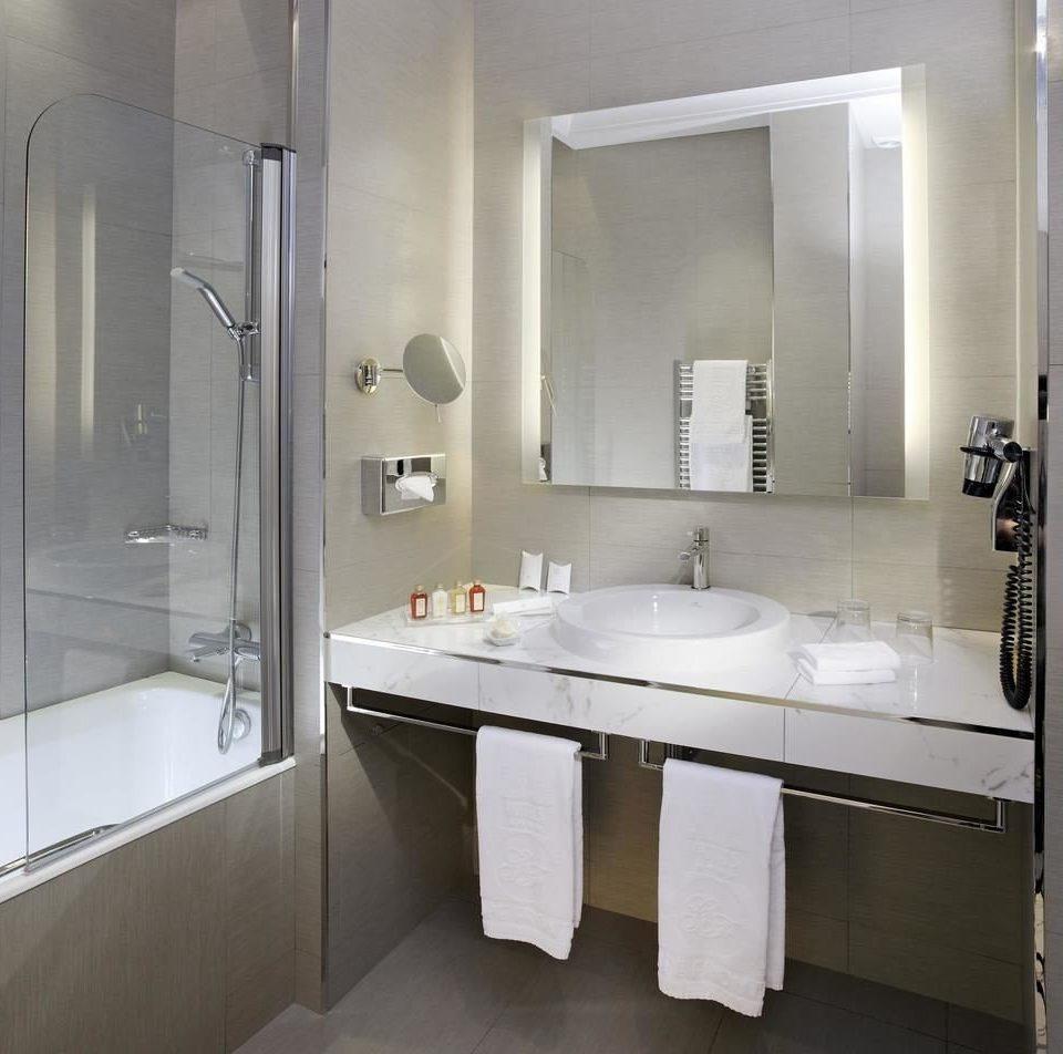 bathroom sink mirror property white toilet plumbing fixture bidet shower towel bathroom cabinet bathtub tan tile