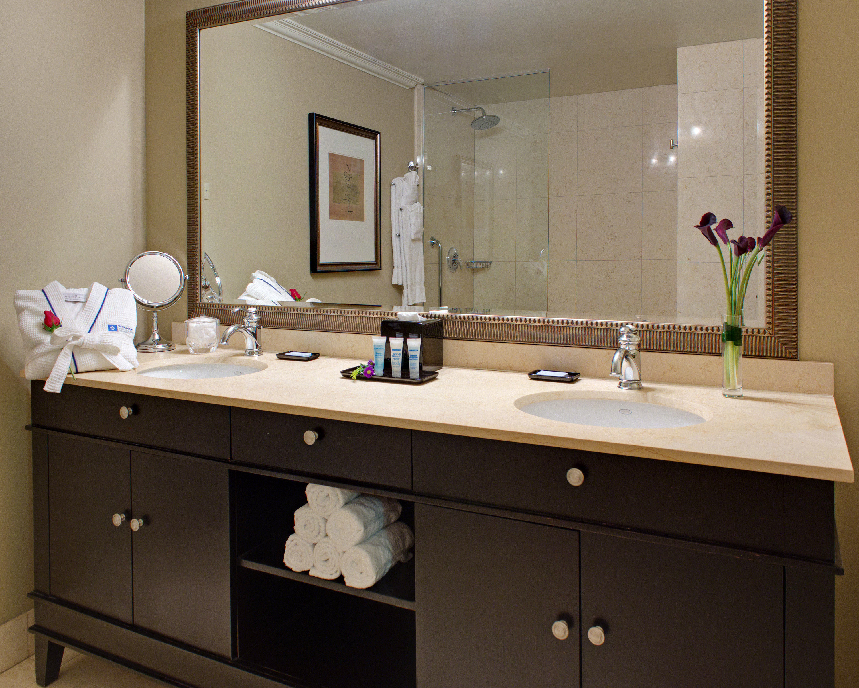 bathroom sink countertop cabinetry plumbing fixture counter bathtub bathroom cabinet