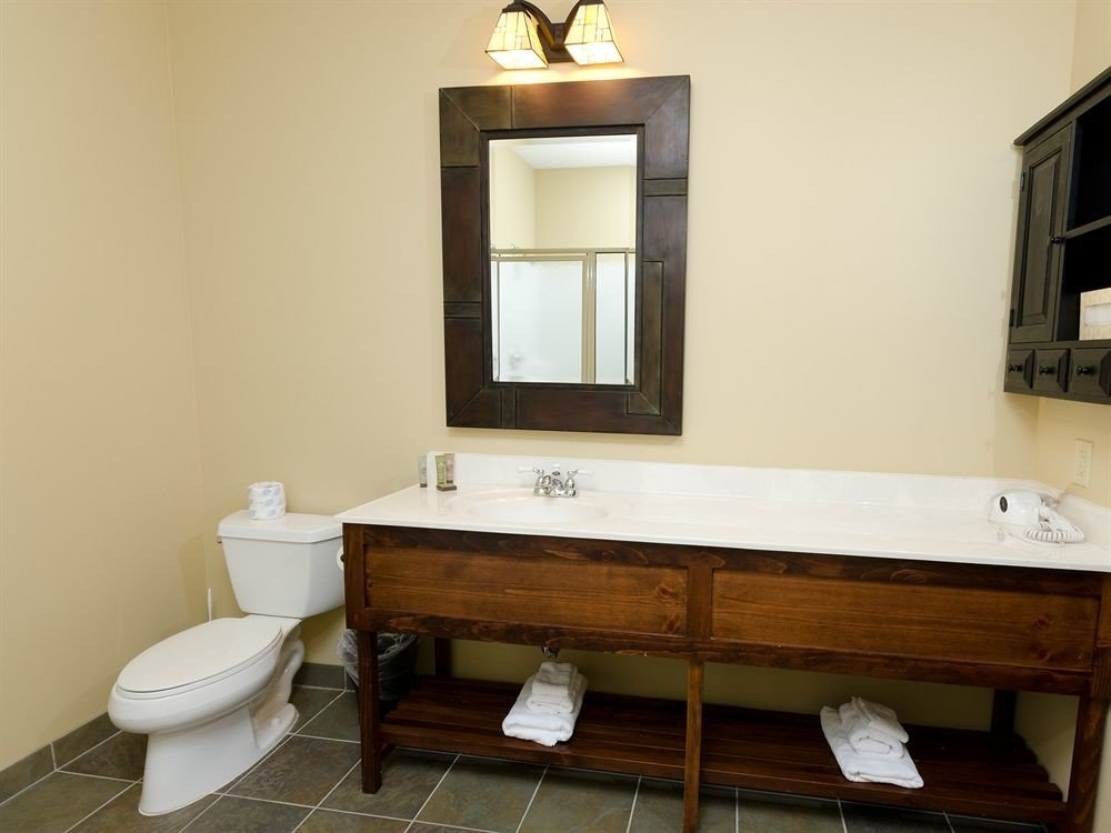 bathroom property sink plumbing fixture bathtub cabinetry bathroom cabinet cottage