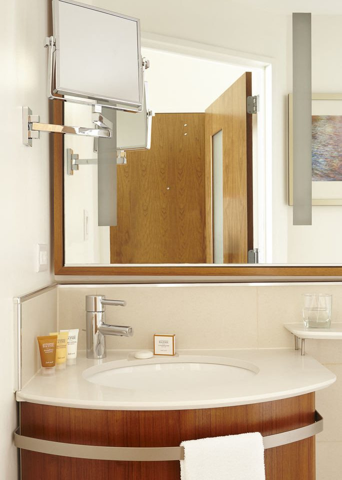 bathroom mirror sink cabinetry plumbing fixture bathroom cabinet bathtub tub tan