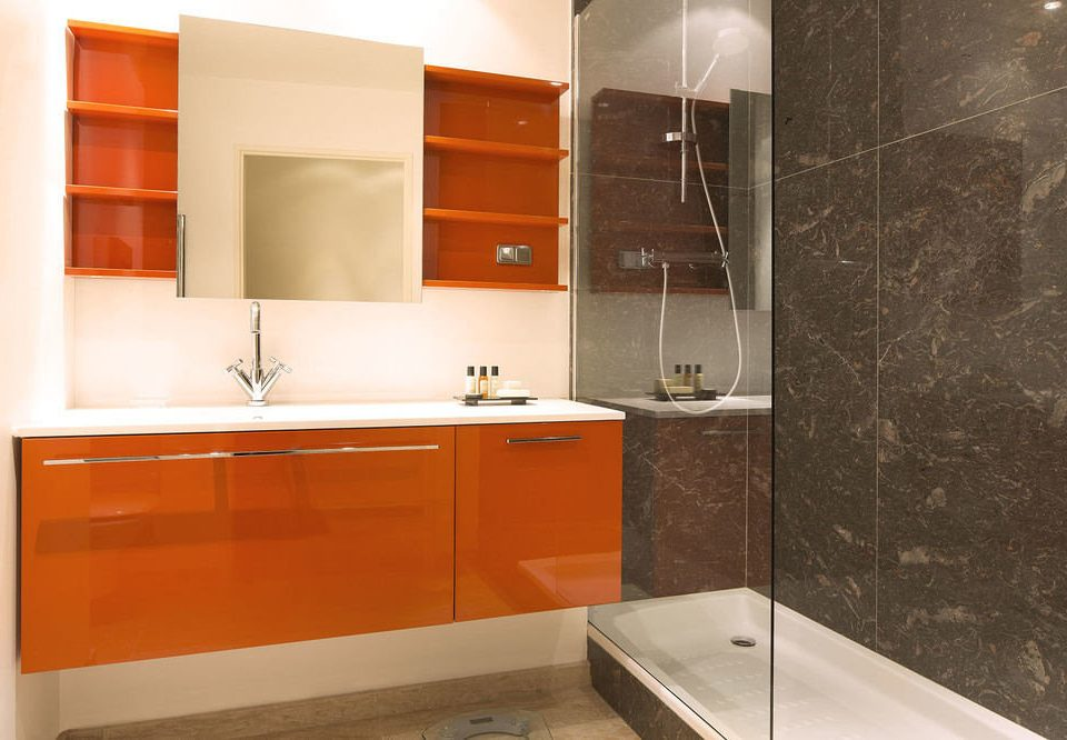 bathroom property orange sink plumbing fixture cabinetry countertop bathtub flooring bathroom cabinet kitchen appliance