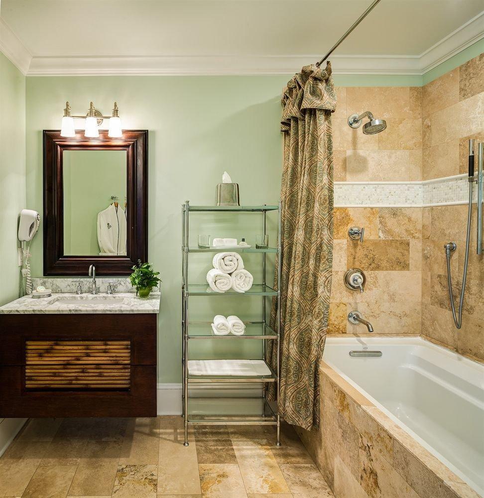 bathroom plumbing fixture cabinetry flooring bathtub bathroom cabinet