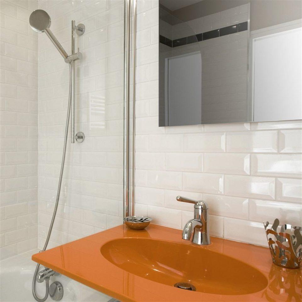 bathroom sink plumbing fixture flooring bathtub bathroom cabinet tile tiled