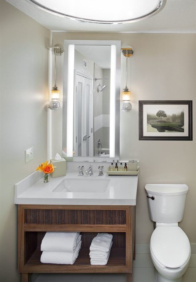 bathroom mirror sink plumbing fixture bathroom cabinet bidet cabinetry rack
