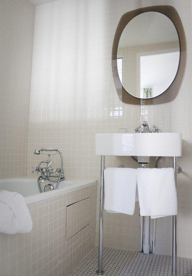 bathroom white bidet plumbing fixture bathroom cabinet sink toilet flooring tile tiled