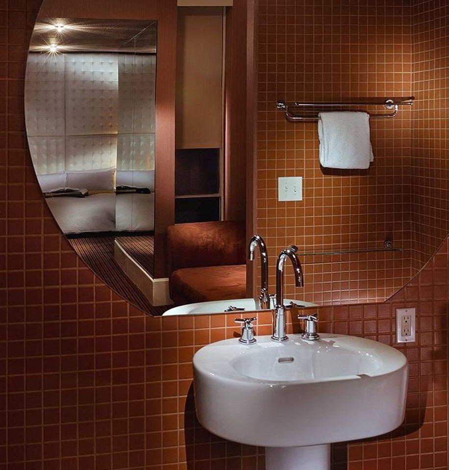 bathroom sink mirror toilet bidet plumbing fixture tile light flooring bathroom cabinet tiled tan