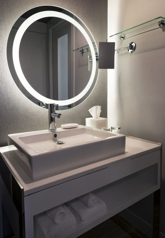 bathroom mirror sink plumbing fixture bidet bathroom cabinet toilet tile tiled