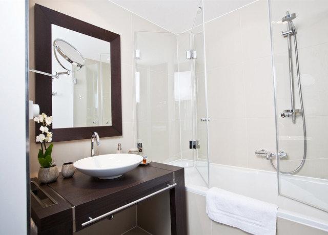 bathroom property scene sink plumbing fixture bidet bathroom cabinet tiled
