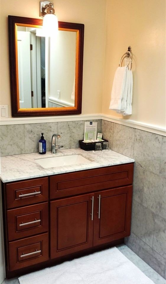 cabinet bathroom sink cabinetry plumbing fixture home countertop bathroom cabinet cottage