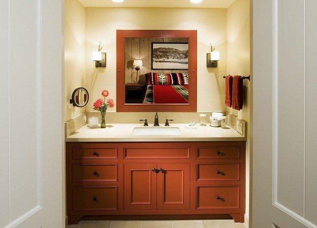 cabinet bathroom cabinetry hardwood home sink bathroom cabinet cottage flooring