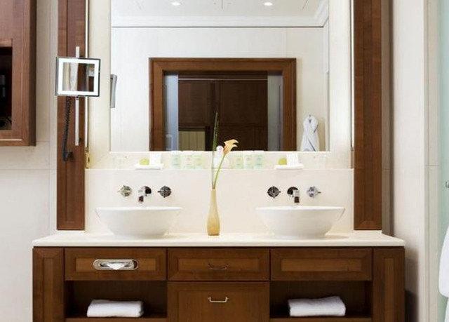 bathroom property sink plumbing fixture home cabinetry bathroom cabinet cottage flooring