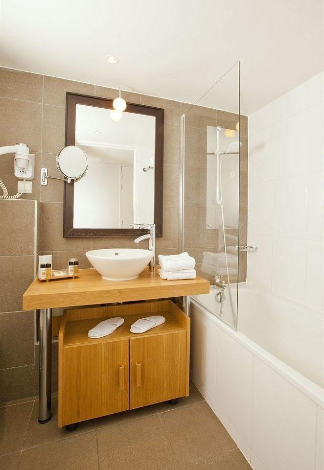 bathroom property plumbing fixture sink home cabinetry bathroom cabinet cottage flooring toilet