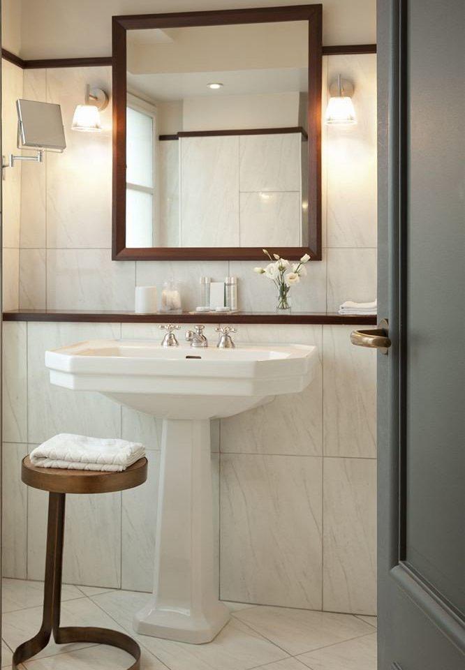 bathroom sink cabinetry plumbing fixture home bathroom cabinet flooring rack tan