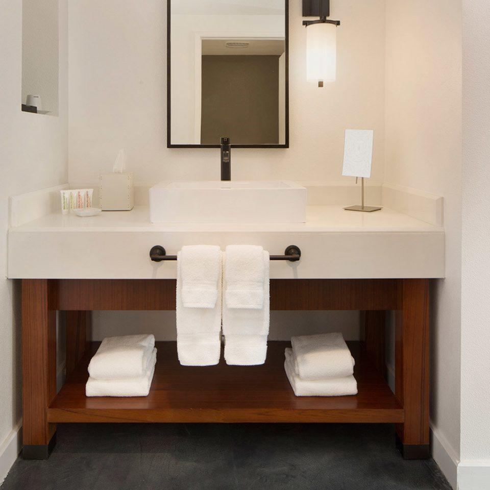bathroom property sink plumbing fixture cabinetry flooring bathroom cabinet