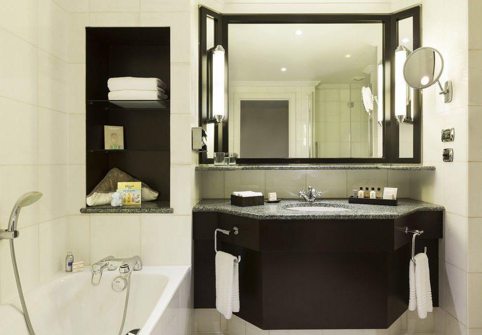 bathroom mirror property sink cabinetry toilet home bathroom cabinet plumbing fixture