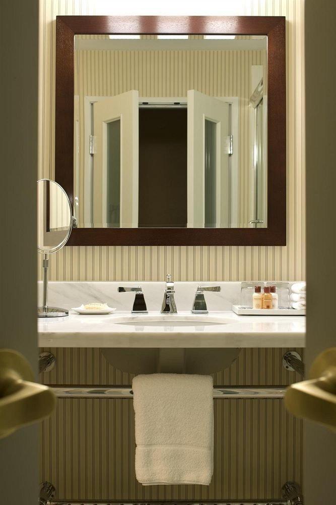 bathroom mirror sink cabinetry towel plumbing fixture bathroom cabinet