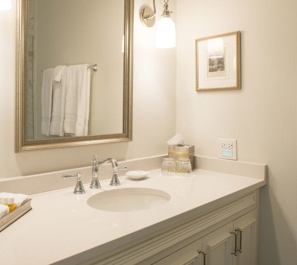 bathroom sink mirror property white home countertop plumbing fixture towel flooring bathroom cabinet clean rack tan