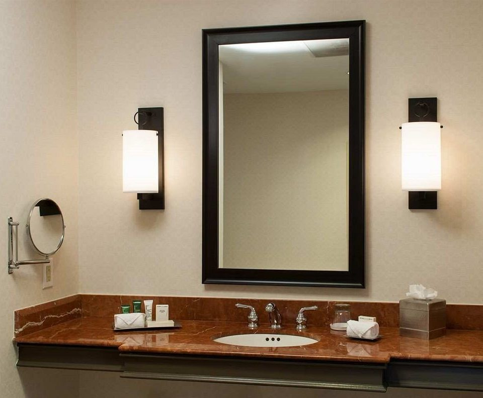 bathroom sink mirror plumbing fixture lighting bathroom cabinet vanity clean tan
