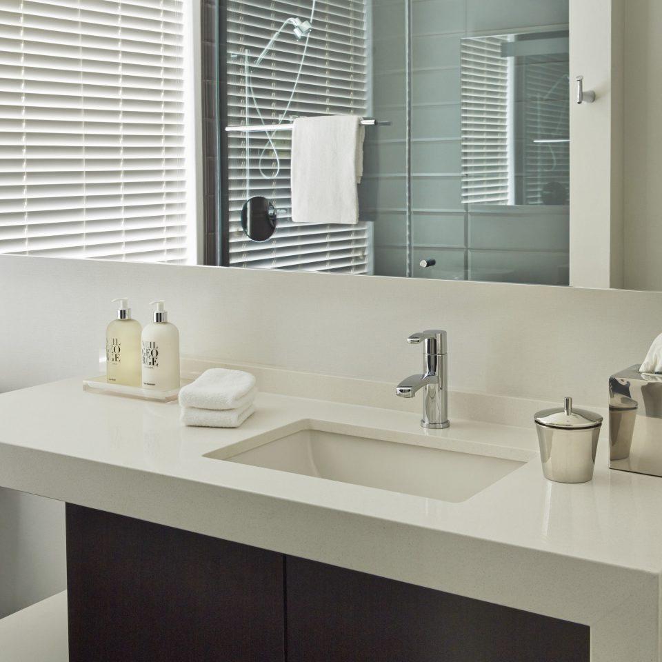 bathroom sink mirror vanity bathroom cabinet toilet plumbing fixture double flooring counter