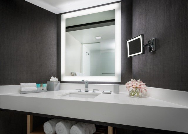 bathroom mirror sink countertop lighting plumbing fixture bathroom cabinet