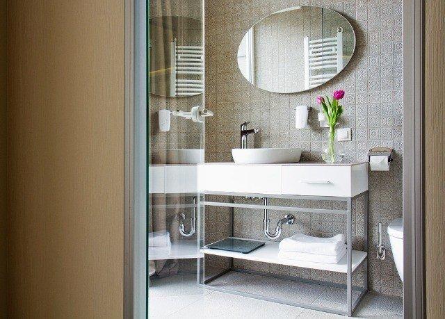 bathroom property home plumbing fixture sink toilet bathroom cabinet door