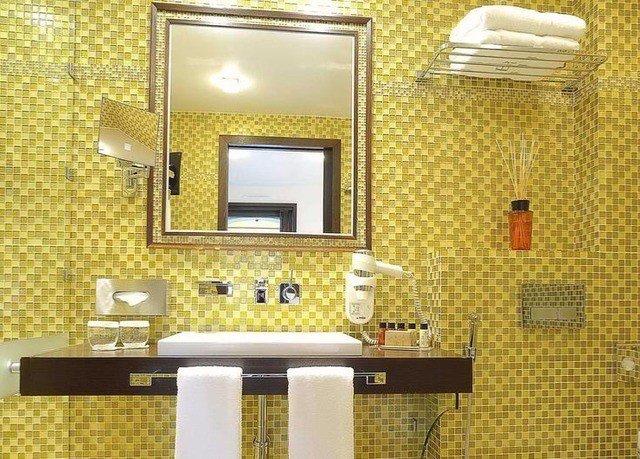 bathroom sink lighting flooring plumbing fixture tile bathroom cabinet tiled