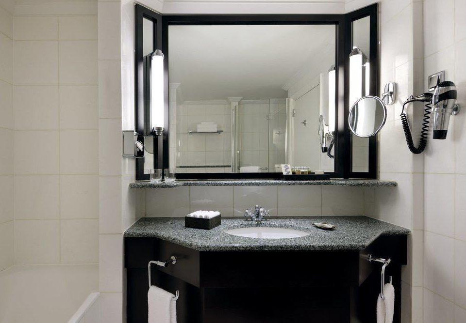 bathroom mirror sink property toilet plumbing fixture bathroom cabinet