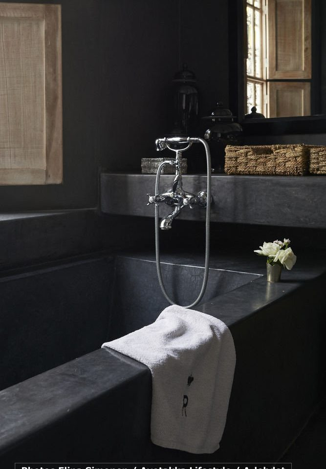 sink bathroom plumbing fixture bathtub black bidet countertop white tap tile flooring dark