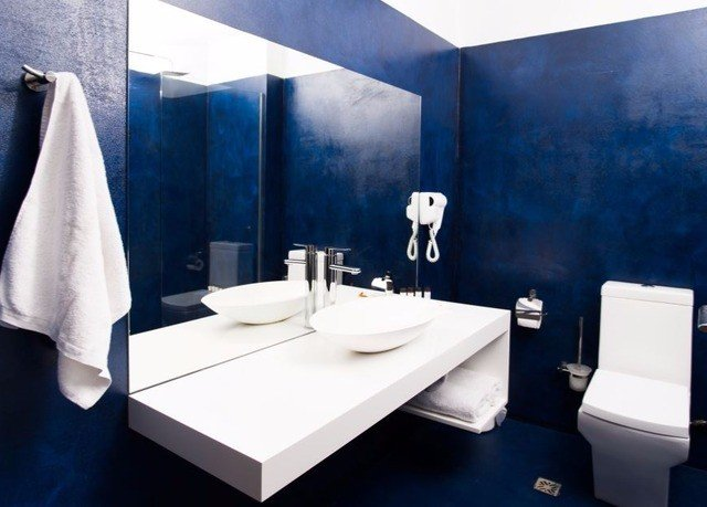 bathroom sink blue bathtub plumbing fixture bidet flooring tiled