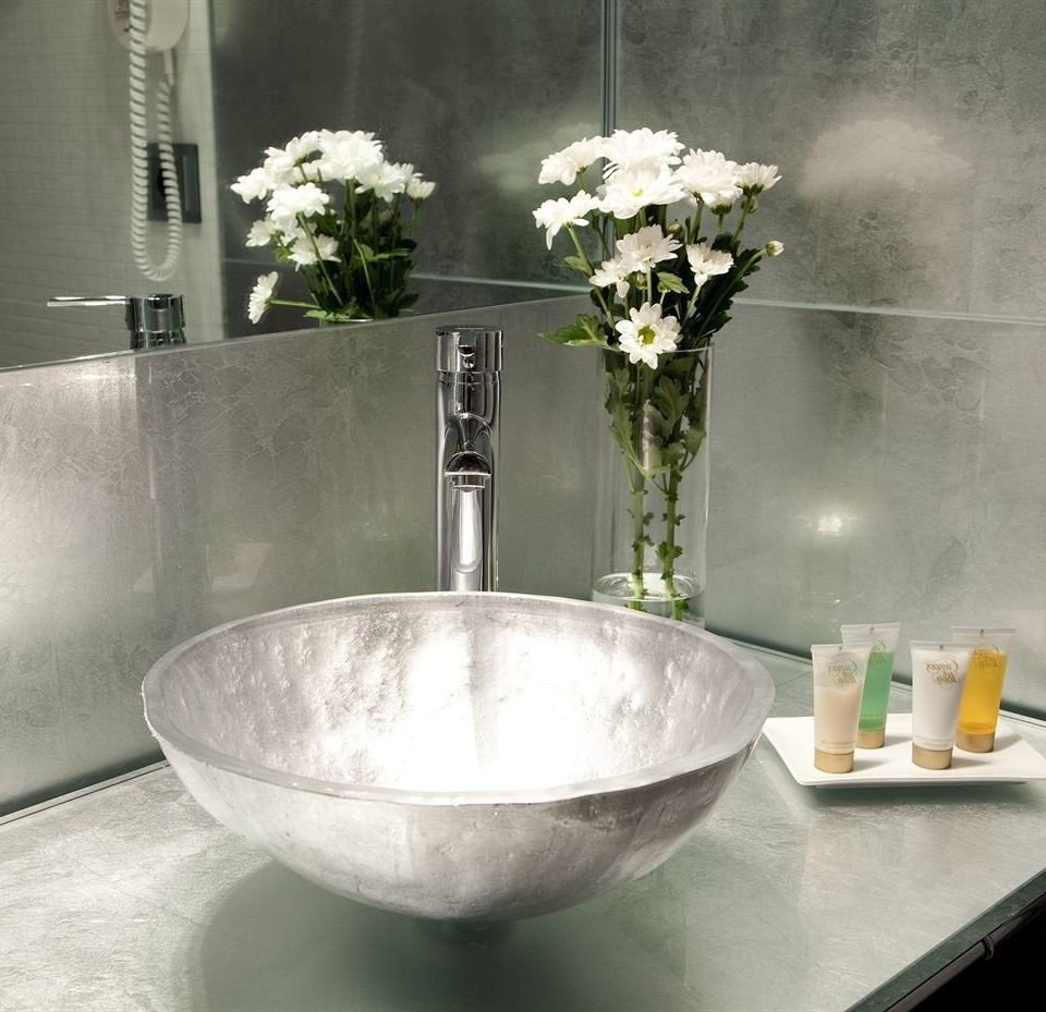 white sink plumbing fixture fountain bathroom bathtub flower bidet glass counter tap ceramic countertop water basin bowl stack